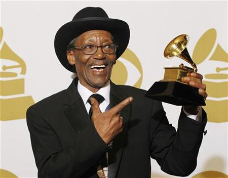 Smith poses with his award at the 53rd annual Grammy Awards in Los Angeles